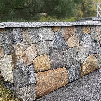 Dry-Stacked-Stone-Wall-Granite-Caps-Paved-Driveway